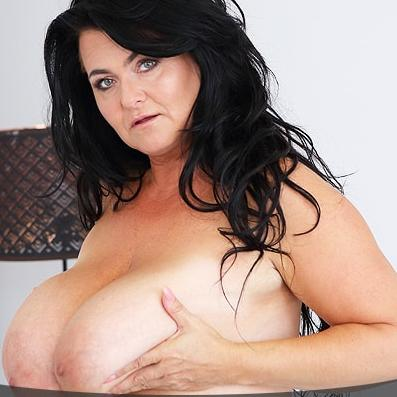 Mature shows her gigantic boobs